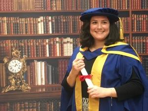 Duygu in her doctoral robe
