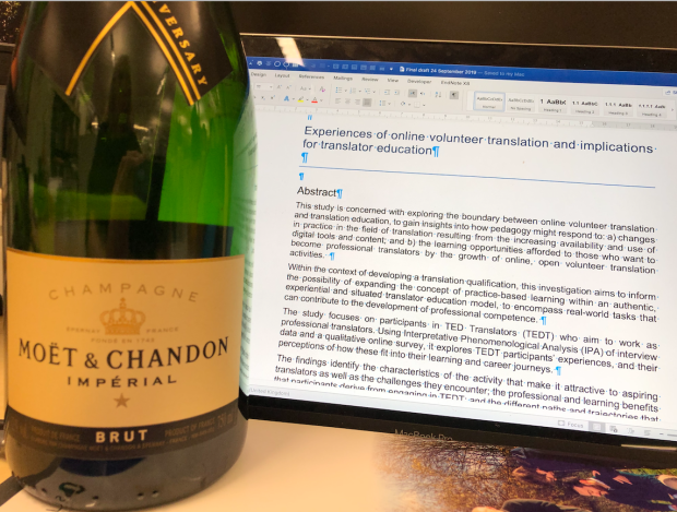 Champagne bottle and thesis text